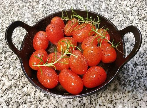 pot with cherry tomatoes and rosemary